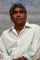 Ashok Amritraj poster